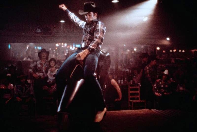 This is John Travolta riding a mechanical bull (geddit) in Urban Cowboy — a film that came out in 1980, when, yes, Uranus was in Taurus's opposite sign, Scorpio.